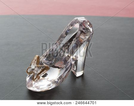Clear Glass Shoe For Cinderella Isolated On Black Background