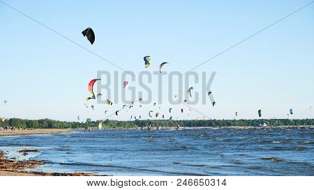 Kitesurfers Ride On Waves In The Summer On The Sea In Windy Weather, Extreme Water Recreation. Slow