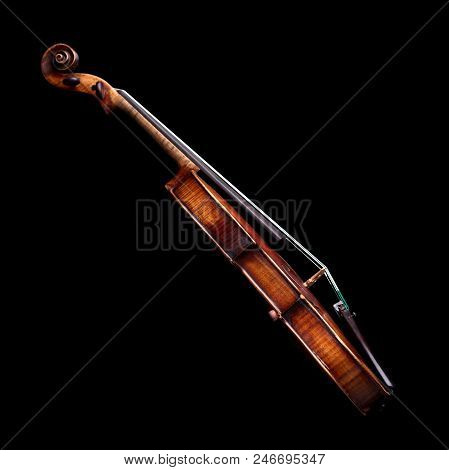 Side View Of A Baroque Violin Isolated On Black Background