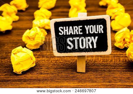 Handwriting text writing Share Your Story. Concept meaning Experience Storytelling Nostalgia Thoughts Memory Personal White text black paint wooden board clip desk yellow paper notes warning poster