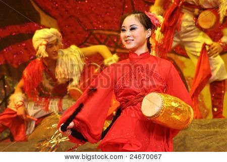 BEIJING, CHINA - NOVEMBER 16: Musicians perform the 'beat the waist drum' dance on November 16, 2005 in Beijing, China. This dance is performed during harvest celebrations in rural China.