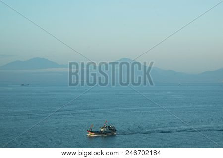 Boats On A Bay In The Early Morning, With The Sunlight Falling On The Old Boat In The Foreground. Th