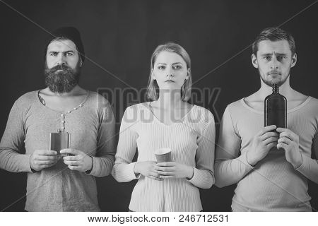 Alcoholism Is A Problem Of Our Time. Guys Hold Cup, Flask With Alcohol, Bottle. Company Of Calm Frie