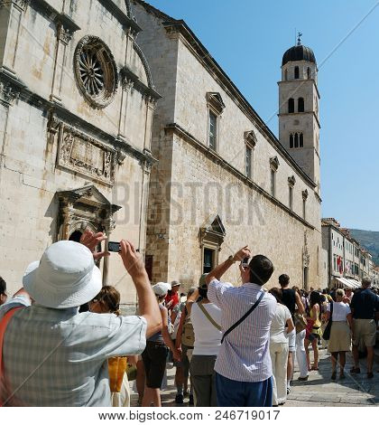 Croatia, Dubrovnik - September 10, 2009: Tourists Photograph The Architecture Of The Ancient City Of