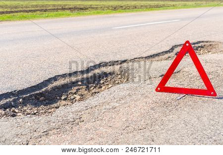 Large Deep Pothole An Example Of Poor Road Maintenance Due To Reducing Local Council Repair Budgets