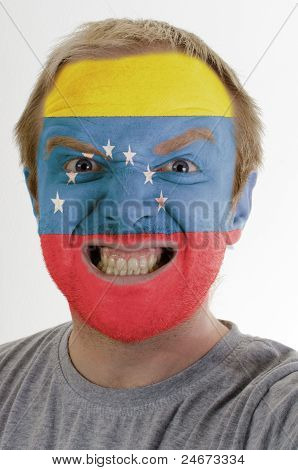 Face Of Crazy Angry Man Painted In Colors Of Venezuela Flag