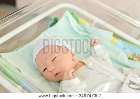 Newborn Baby Laying In Crib In Prenatal Hospital