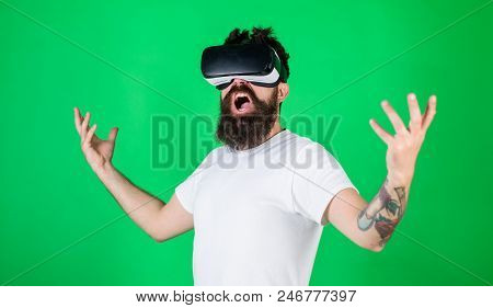Guy With Head Mounted Display Interact In Vr. Man With Beard In Vr Glasses, Green Background. Power