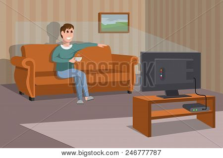 Man Watching Tv On Sofa. Man With Coffee Cup. Evening Watching Television Series. Interior Of The Ro