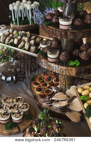 Candy bar with various desserts for birthday party or wedding poster