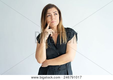 Pensive Worried Young Woman Lost In Thoughts And Looking Away. Thoughtful Attractive Girl In Black T