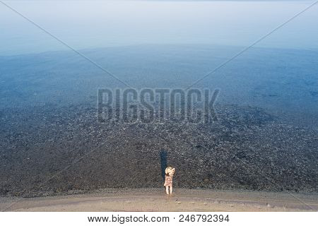 Aerial View Of The Woman Looking At The Sea