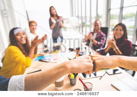 Business Partners Or Men Coworkers Fist Bump In Team Meeting, Multiethnic Diverse Group Of Happy Col
