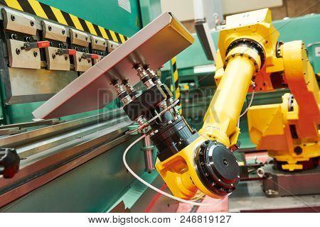 Robotics in hydraulic press brake or bending machine for sheet metal.