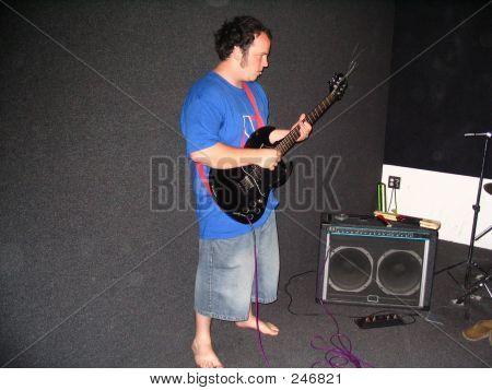 Barefoot Guitar Player