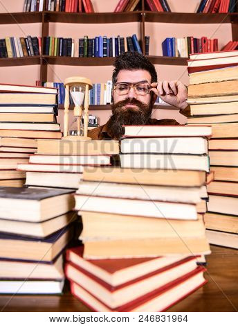 Time Flow Concept. Teacher Or Student With Beard Studying In Library. Man On Serious Face Watching T