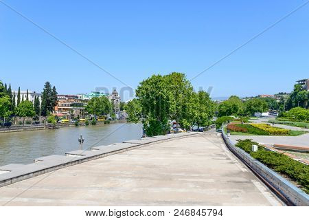 TBILISI - MAY 3: Tourists enjoy the sunny weather and walk around Rike Park on the Kura River on 3 May 2018 in Tbilisi, Georgia. Rike Park is a part of modern Tbilisi.
