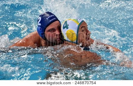 Budapest, Hungary - Jul 17, 2017. TOROK Bela, hungarian waterpolo player (in blue) fights with KAYES Joe (AUS). FINA Waterpolo World Championship was held in Alfred Hajos Swimming Centre.