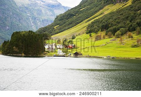 Landscape With Naeroyfjord, Mountains And Traditional Village In Norway.