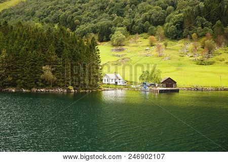 Landscape With Naeroyfjord, Forest And Traditional Village Houses In Norway.