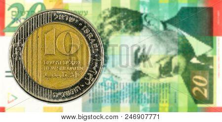 10 Shekel Coin Against 20 Israeli New Shekel Bank Note Obverse