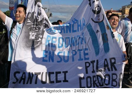 ST. PETERSBURG, RUSSIA - JUNE 25, 2018: Argentinian football fans with a banner on the bridge on the day before FIFA World Cup 2018 match Argentina vs Nigeria. They call on Lionel Messi to revenge