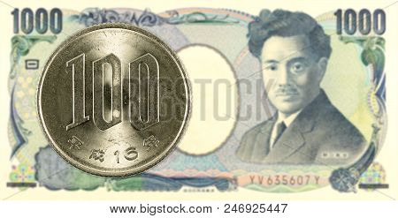 100 Japanese Yen Coin Against 1000 Japanese Yen Bank Note Obverse