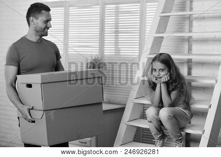 Kid And Guy Move In Or Move Out. New Home And Family Concept. Daughter And Father Hold Boxes And Unp
