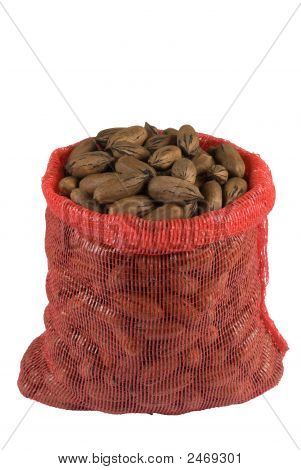 A Sack Of Pecan Nuts Isolated On White