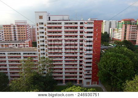 Singapore-25 Jun, 2018: Singapore Residential Housing Estate With Apartment Blocks Against A Cloudy