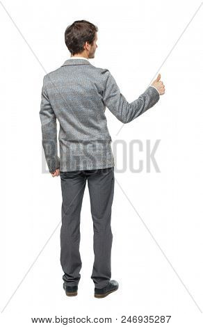 back view of business man thumbs up. rear view. Isolated over white . Rear view people collection. backside view of person. Isolated over white background. A young guy in a gray suit signals success