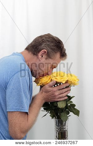 Male Holding And Smelling A Bunch Of Yellow Roses. Bouquet Of Yellow Roses Being Held And Smelled. D