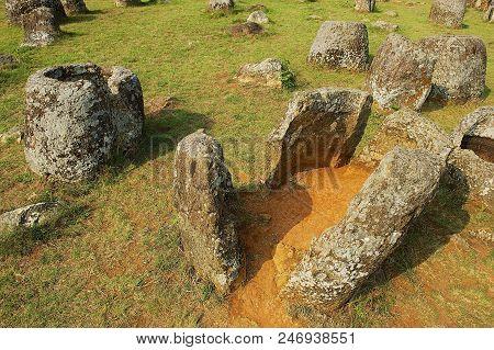 Ancient Stone Jars In A Plain Of Jars (site #1) Near Phonsavan, Xienghouang Province, Laos. Unesco W