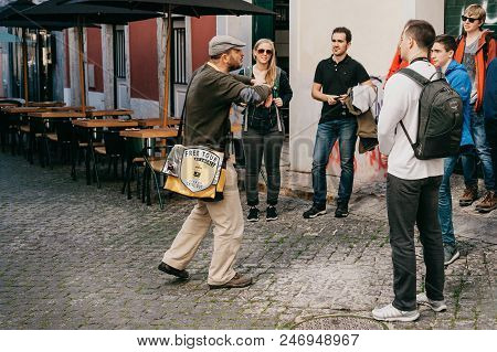 Lisbon, June 18, 2018: A Guide From Local Residents Tells Tourists On A Free Tour Of The Sights Of T