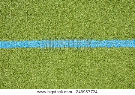 Football Lawn With Blue Lane Mark. Soccer Closeup Detail Wallpaper Texture.