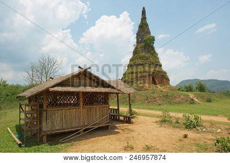 Phonsavan, Laos - April 19, 2012: View To The Wat Phra That Fun Or That Fun Ancient Stupa Near The P