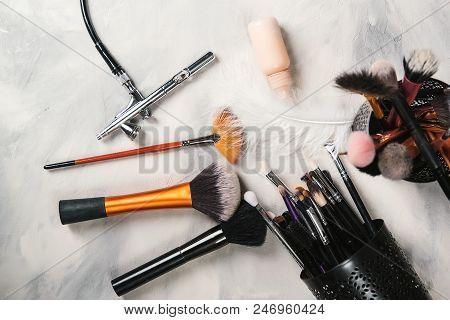 Makeup Tools For Professional Makeup Artist. Makeup Brushes. Airbrush And Jar Of Paint. Makeup Tools