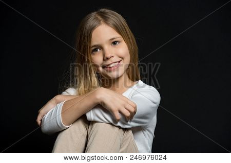 Cute And Shy. Girl Long Hair Cute Smiling Face Relaxing, Black Background. Overcome Shyness In Easy