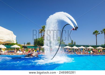 Side, Turkey - June 8, 2018: Flyboard show at the pool of TT Pegasos World hotel in Turkey. Waterpark at Pegasos World Hotel is a popular tourist destination at Turkish Riviera.