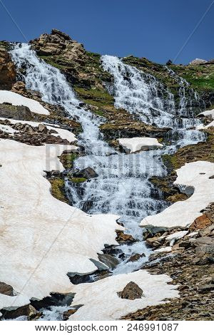 Waterfall With Ice And Snowfields In Mulhacen Peak Route