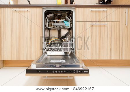 Image of open dishwasher with dirty dishes