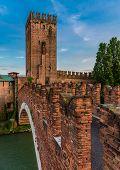 The Castel Vecchio Bridge (or Scaliger Bridge), a medieval fortified bridge in Verona, that spans river Adige, in Veneto, Italy. poster