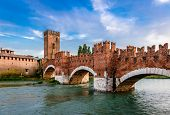 The Castel Vecchio Bridge (or Scaliger Bridge), a medieval fortified bridge that spans river Adige in Verona, Veneto, Italy. poster