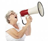 portrait of a happy senior woman shouting with megaphone over white background poster