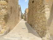 Cobblestone alley in the medieval village of Pals, located in the middle of the Emporda region of Girona, Catalonia, Spain. poster