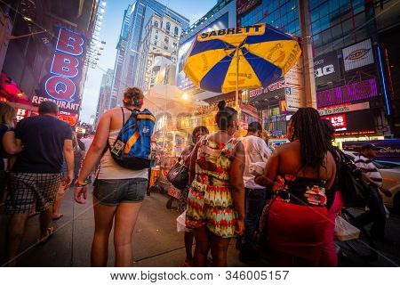 People In Times Square, Manhattan, New York, Usa