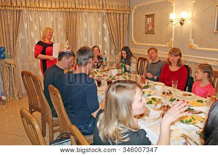 Chernihiv / Ukraine. 21 February 2015:  Guests Gathered Together At Festive Table. Happy People Sitt