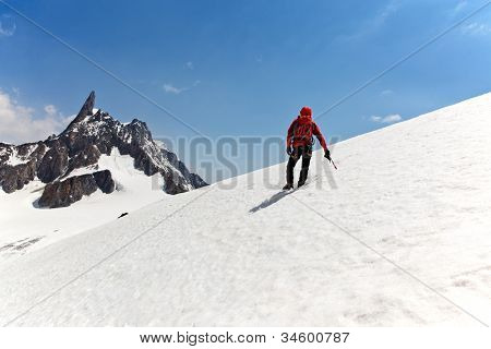 A male mountaineer on the way for reach the summit. Dent du Geant, Mont Blanc, Chamonix, France.