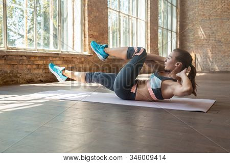 Sporty Fit Active Young Woman Doing Bicycle Crunch Situp Exercise Alone Lying On Mat Wooden Floor, S