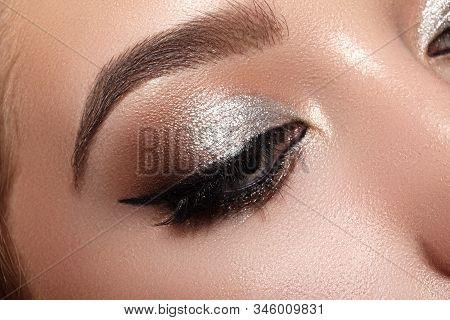 Beautiful Woman With Professional Makeup. Closeup Macro Of Woman Face With Cat-eye Make-up. Fashion